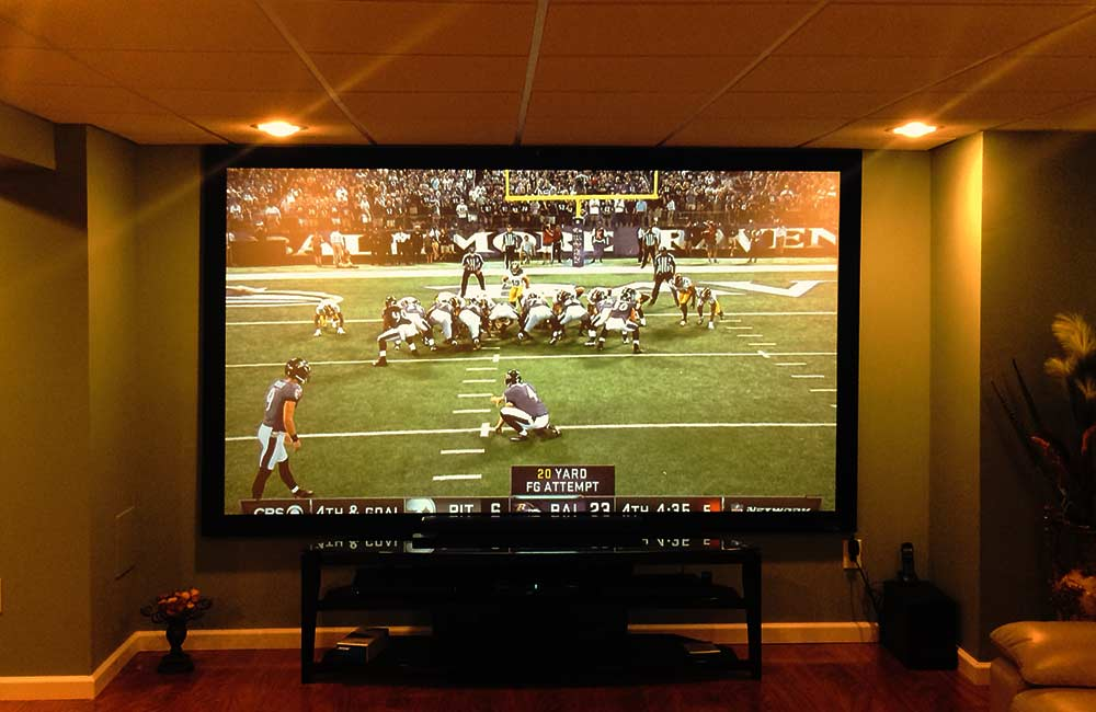 watching football with a projector on a big screen