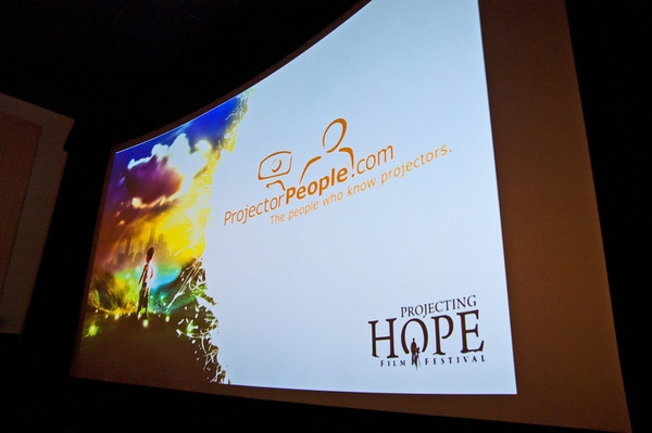 church presentation shown on a big screen projector